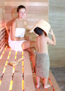 kid playing in TOLO sauna room
